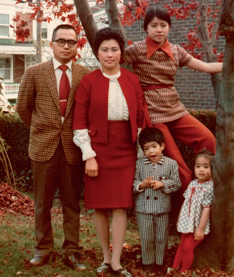 Ruey Yu, his wife and three children pose beside a tree in a residential neighbourhood.