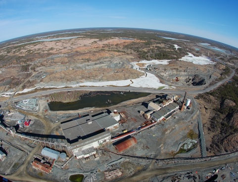 A view of the Giant Mine site from the air, with the curvature of the earth on the horizon.